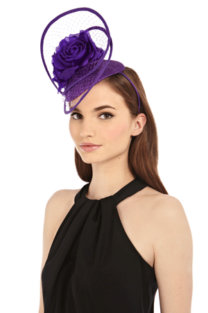 This hatinator is an ideal eyecatching piece to lift a simple dress. Whilst it suits black perfectly, step into spring by pairing it with a cream look or colour block it with another jewel tone like a hot pink dress. Nelly Hatinator, Coast, 78 euro